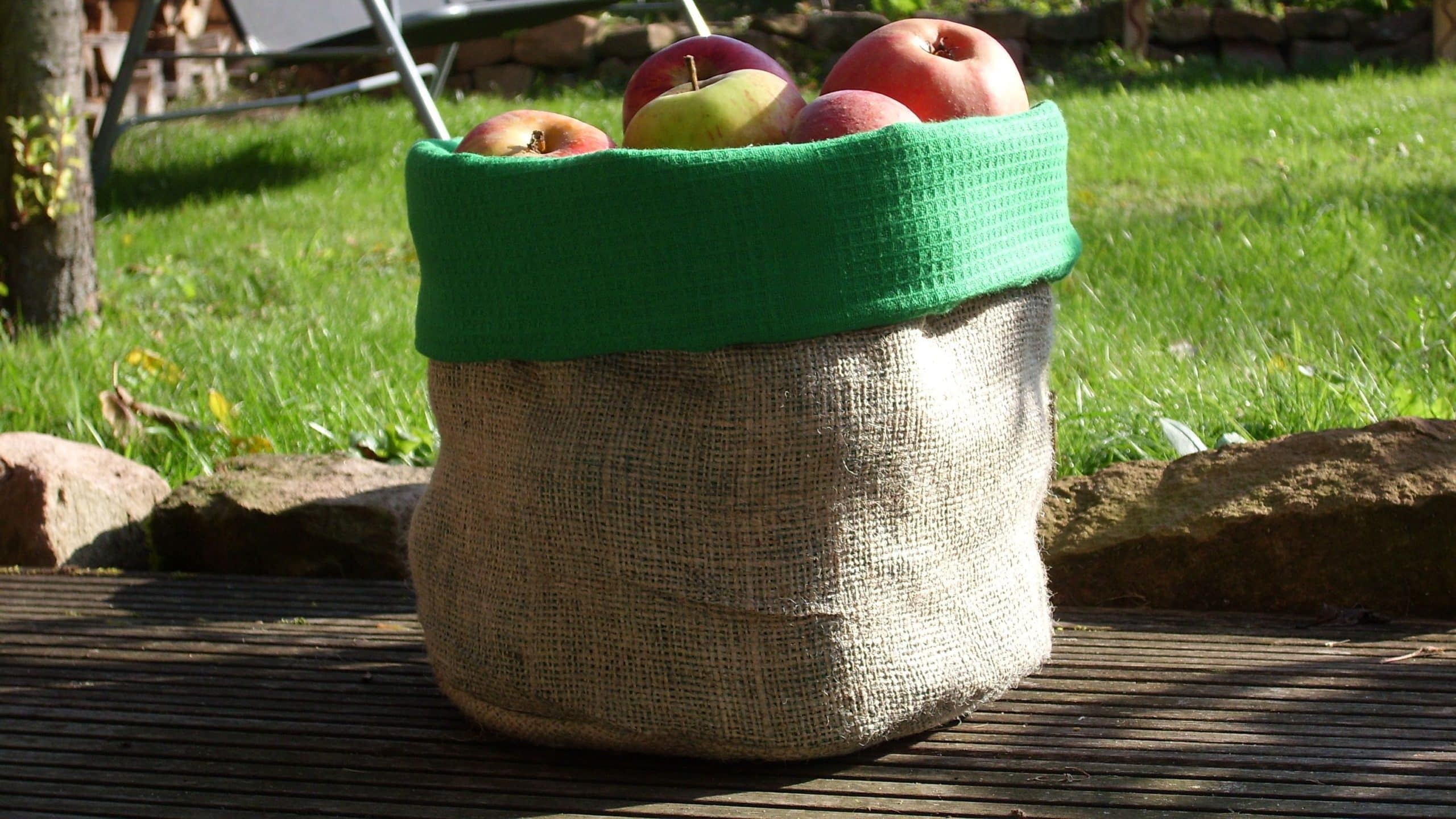 jute bag filled with apples