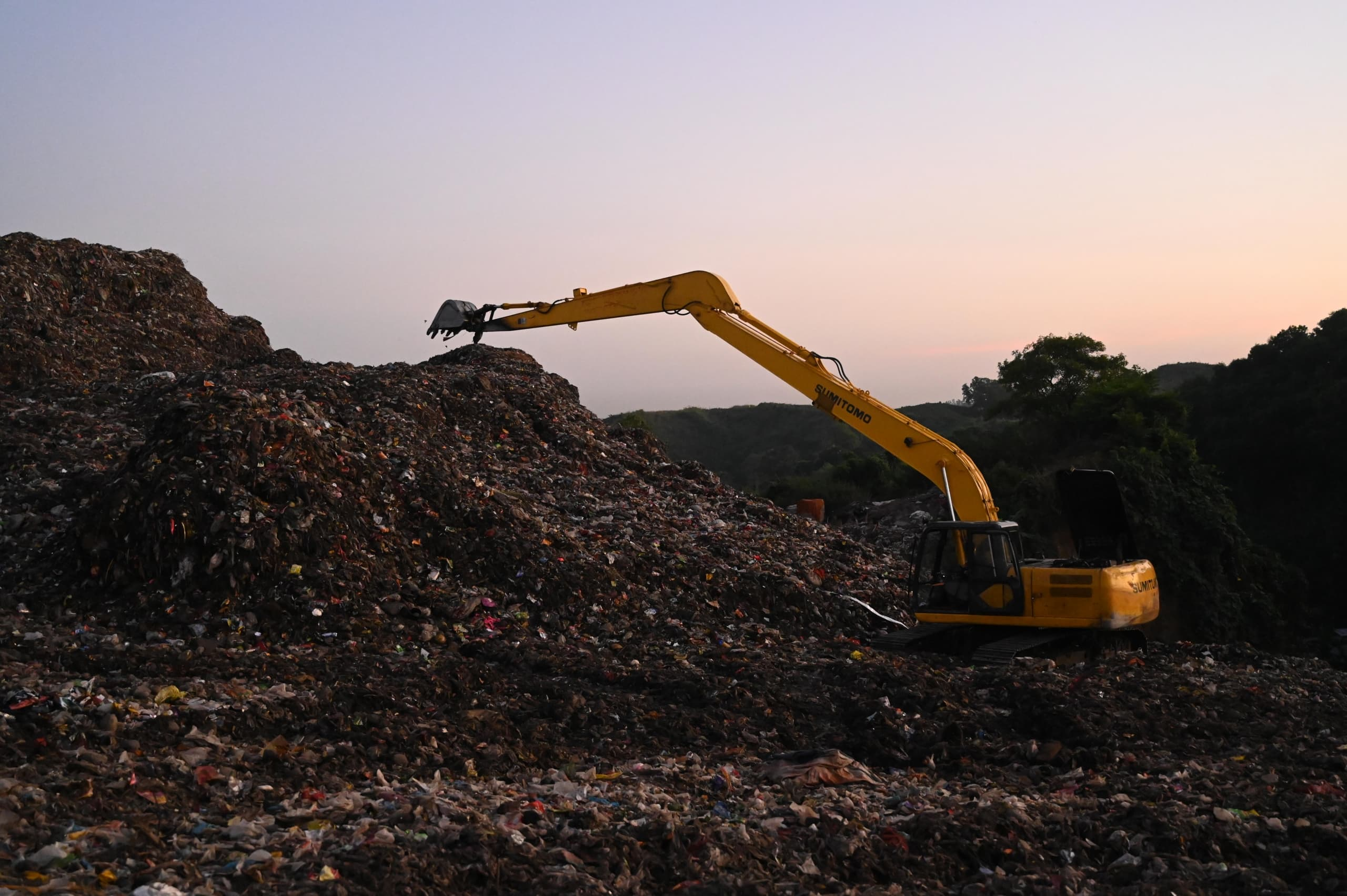 photo-of-backhoe-on-landfill-3230538.jpg ATTACHMENT DETAILS photo-of-backhoe-on-landfill