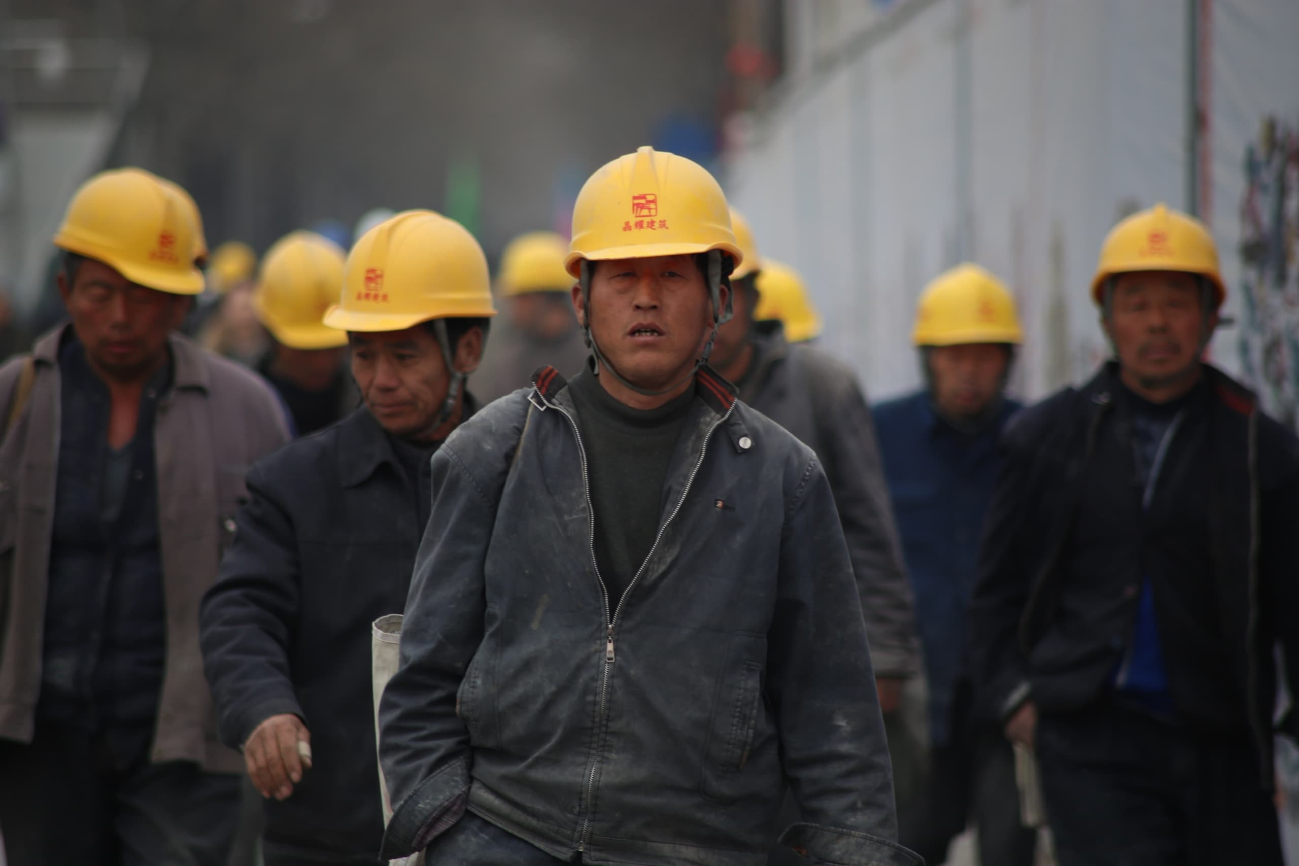 group of worker wearing yellow safety helmet